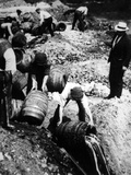 A Us Federal Agent Oversees the Destruction of Beer Kegs During the American Prohibition Era…