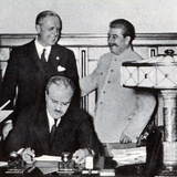 Stalin Pats Ribbentrop on the Back  While Molotov Scans the Signed Pact Which Partitioned Poland …
