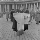 A Woman Reads the News of the Election of Pope John XXIII  Vatican City  4th November 1958