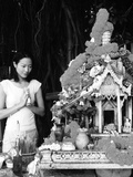 Girl Praying at a Spirit House