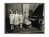 Woman Playing the Piano While Three Girls Sing at the New York Association