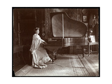 Mrs I M Clark Seated at a Grand Piano  1904