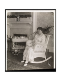 Mrs Howard Seated with a Book in a Rocking Chair at Her Home at 200  5th Avenue  New York  1915-6