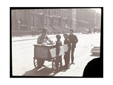 View of an Ice Cream Peddler on the Street  with Three Newsboys Buying Ice Cream  New York  c1901
