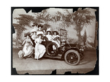 Eight Costumed Women Posed in and around an Automobile on a Stage with a Landscape Backdrop …