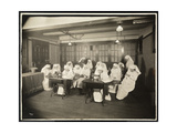 Women Wearing White Smocks  in a Sewing Class  Presumably During or Associated with World War I …