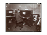 A Man Playing a Player Piano in a Piano Showroom in New York  1907