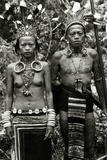 Dayak Couple in Traditional Dress and Tattoos  c1920