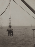 A Traveller Is Hoisted in a Chair from a Launch Boat onto the Pier  Acajutla  El Salvador  1922