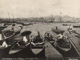 Men Sit in Bobbing Boats Docked in the Golden Horn Inlet  Turkey  1922