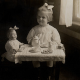 Girl Playing with a Tea Set  1900