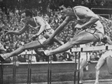 William Porter (To Right of Viewer) on His Way to Winning Gold in the 110 M Hurdles Event with a…