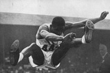 Willie Steele on His Way to Winning a Gold Medal for the Long Jump in the 1948 London Olympic Games