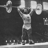 Joe Depietro on His Way to Winning Gold in the Bantam-Weight Weightlifting Event at the 1948…