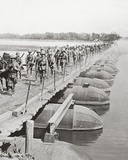 Machine Gun Section and Infantry Crossing a Flooded River by Pontoon Bridge