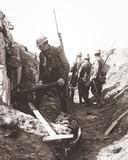 'Bosche' Machine Gun Captured and Gunner Taken Prisoner by Our Advancing Troops at 'Ping Street'