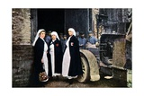 Three Women Wearing the Red Cross and the French Ambulance Staff with a Veh