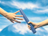 Human Hand Passing Relay Baton