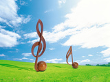Wooden Musical Notes in Field