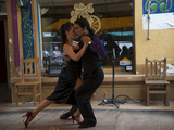 Tango Dancers Employed by Restaurant Dancing for Customers