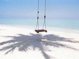 Beach Swing And Shadow of Palm Tree on Sand Papier Photo par Green Light Collection