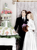From left: Ronald Reagan and Jane Wyman admire the cake at their wedding reception  1940