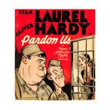 PARDON US  from left: Oliver Hardy  Stan Laurel on window card  1931
