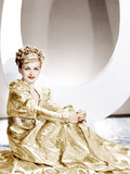 ARTISTS AND MODELS ABROAD  Joan Bennett wearing a gold lame negligee designed by Edith Head  1938