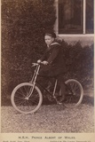 Prince Albert of Wales Poses Only a Bicycle