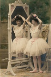 A Young Woman Wearing a Ballet Tutu Looks at Her Reflection in a Mirror