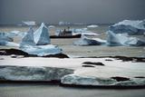 Ship RRS Bransfield Among Icebergs