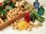 Four Bottles of Aromatherapy Oil with Loose Herbs