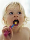 Baby Girl Brushing Teeth