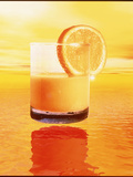 Computer Art of Glass of Orange Juice & Orange Sea