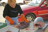Market Trader Slicing Fish