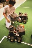 Technician Programs Robot Footballer At RoboCup-98
