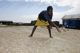Woman Sorting Fish  Kenya
