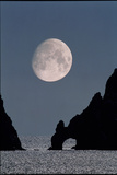 Gibbous Moon Rising Over a Coastal Cliff