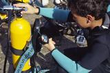 Young Scuba Diver Checking Kit