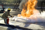 Firefighter Extinguishing a Fire