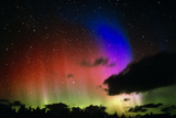 Aurora Borealis Display with Clouds