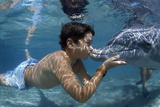 Boy Kissing Dolphin