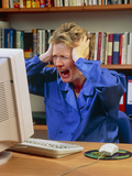 Stressed Woman Shouting At An Office Computer