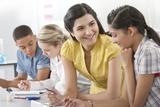 Teacher Helping Pupil