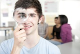 Teenage Boy with Magnifying Glass