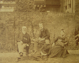 Dr William R Woodman (1828-91) with His Family at their London Home  C1887