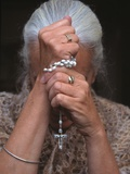 Catholic Woman Prays Holding Her Rosary