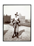 A Man on a Rooftop Dressed in a Traditional Military Uniform  Holding a Rifle  1895