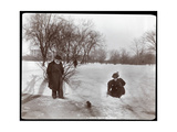 View of a Woman Feeding a Squirrel While a Man Looks on in the Snow at Central Park  New York  1898