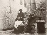Two Men Sitting Next to the Lintel of Barclay's Gate in the Western Wall of Temple Mount …